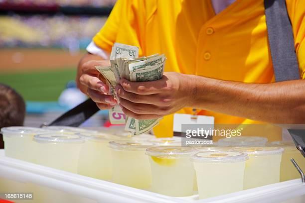 Close Up Lemonade Vendor at baseball game make change