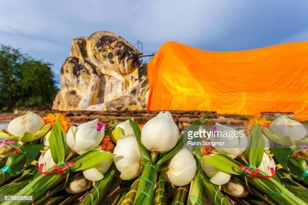 Close up lotus and flower for pray big reclining buddha statue at Wat Lokayasutharam, Ayutthaya Province, Thailand