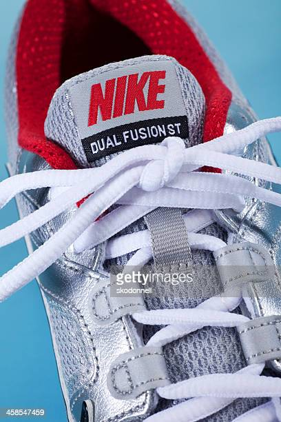 close up nike running shoe - nike sports shoe stock pictures, royalty-free photos & images
