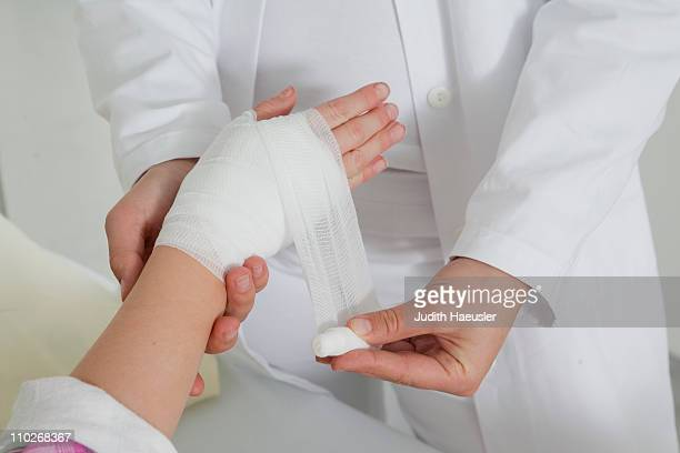 Close up nurse applying a dressing