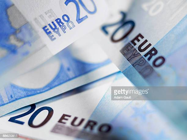 close up of 20 euro notes - twenty euro banknote stock photos and pictures