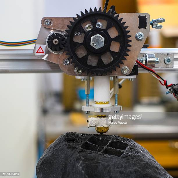 A close up of a 3D printer polytechnic lab in Milano working to reproduce a mock up of a piece of rock of an asteroid