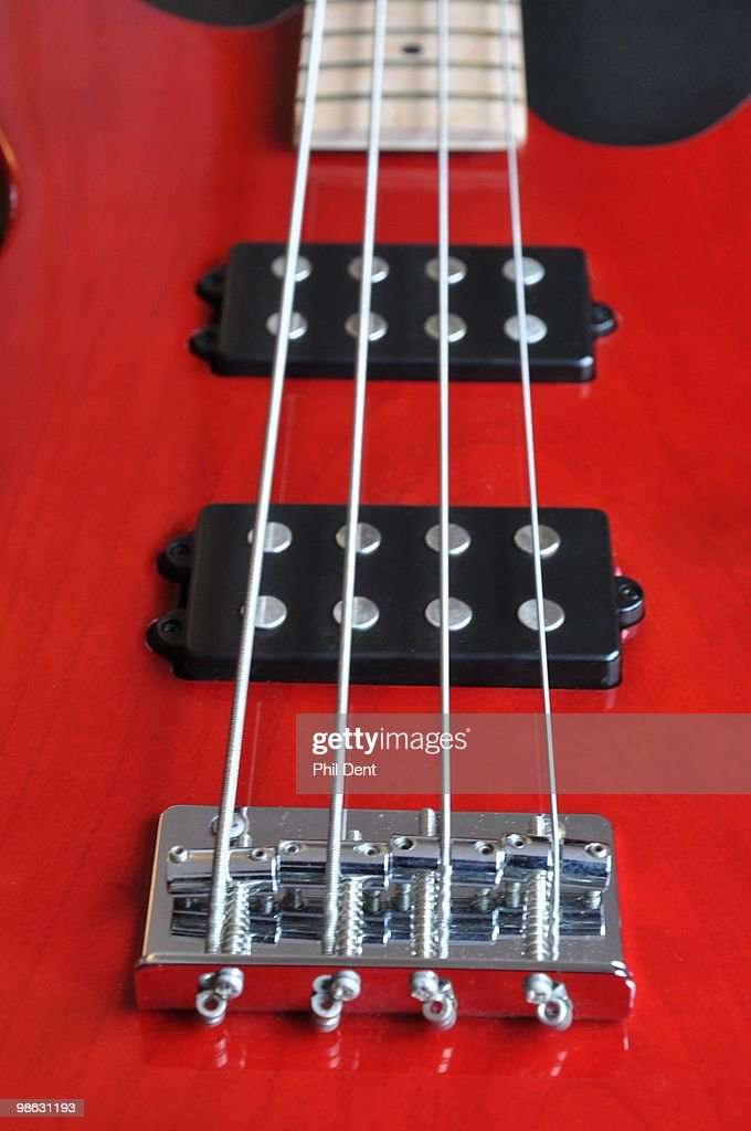 Close up of a bass guitar showing humbucker pickups and bridge, on 25th March 2010 in United Kingdom.