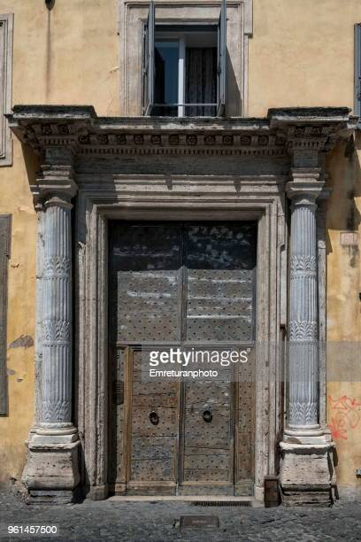 Close up of a beautiful old building door in Rome.
