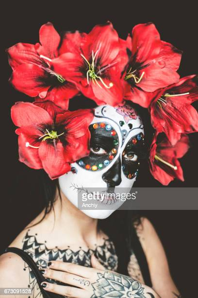 close up of a beautiful woman wearing dia de los muertos make up - mexican fiesta stock pictures, royalty-free photos & images