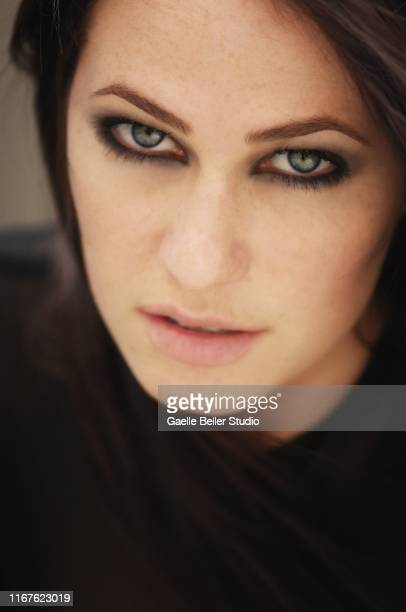 close up of a beautiful young woman with blue eyes - smokey eyeshadow stock pictures, royalty-free photos & images