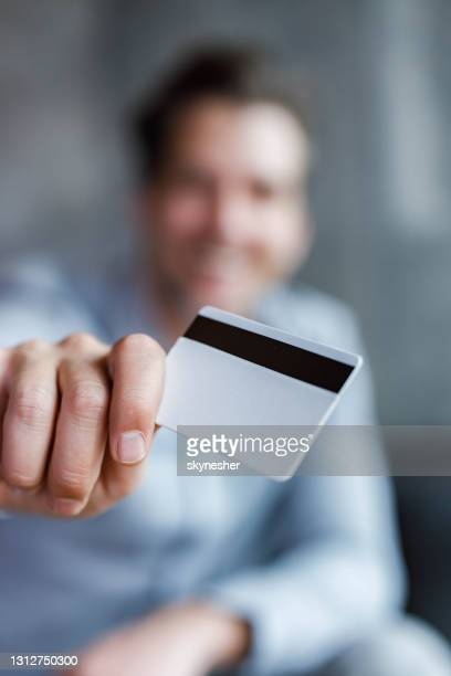 close up of a blank credit card in man's hand. - vertical stock pictures, royalty-free photos & images