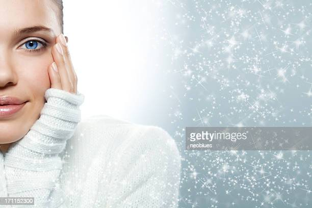 Close up of a blue eyed woman in a white sweater