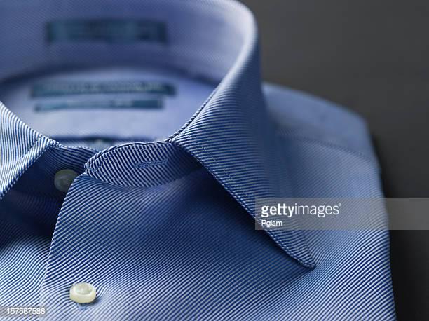 Close up of a blue mens shirts