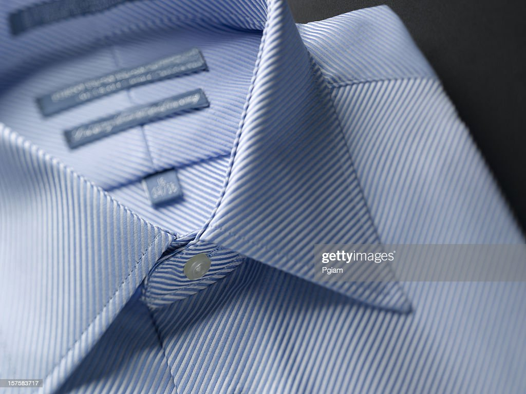 Close up of a blue mens shirts : Stock Photo