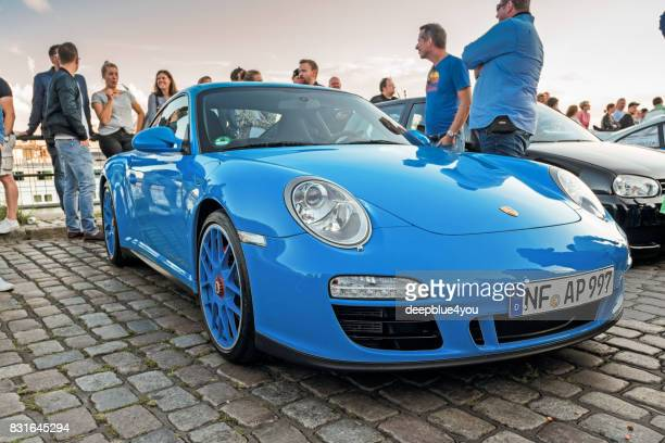 Close up of a blue Porsche Carrera GTS during the Magnus Walker event on the Fischmarkt Hamburg