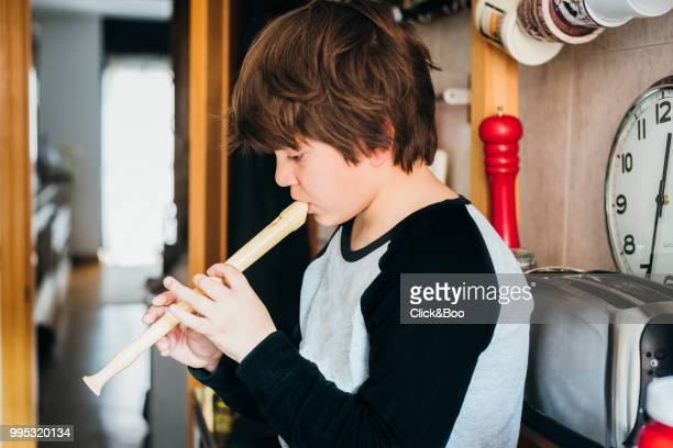 Close up of a boy playing the flute