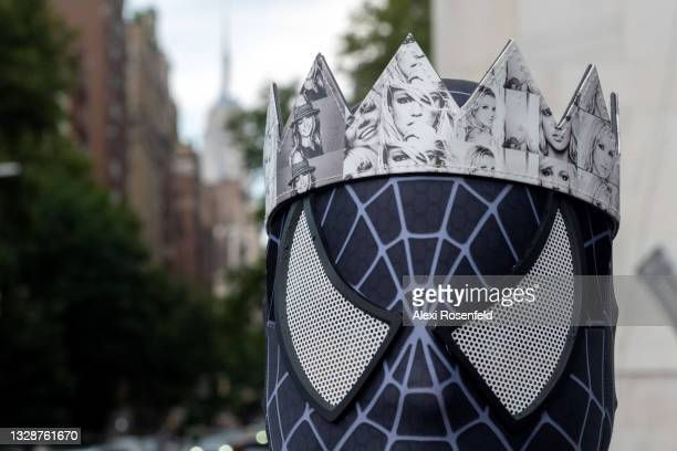 Close up of a Britney Spears supporter dressed in Marvel's Spiderman costume wears a Britney crown at the #FreeBritney Rally in Washington Square...