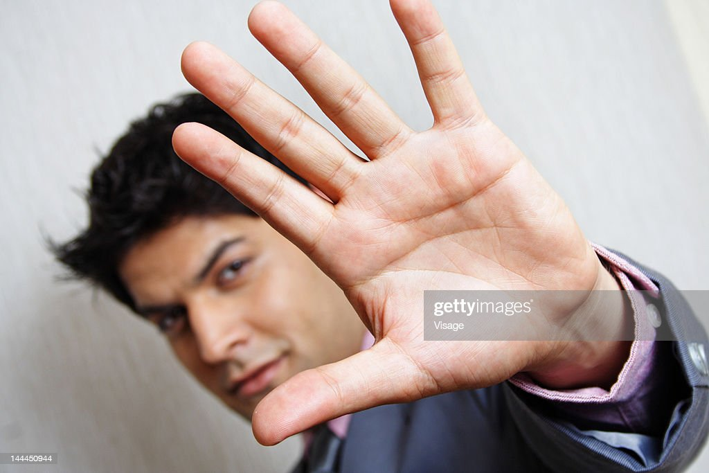 Close up of a business man gesturing stop : Stock Photo
