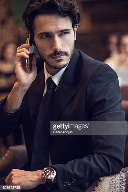 close up of a businessman talking on his smartphone