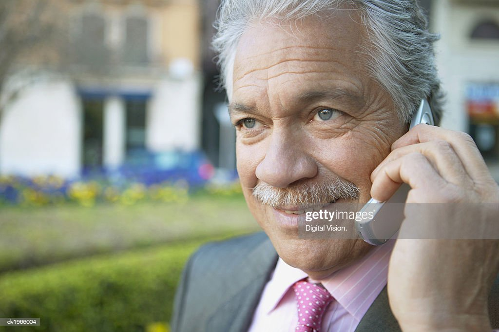Close up of a Businessman Using a Mobile Phone : Stock Photo