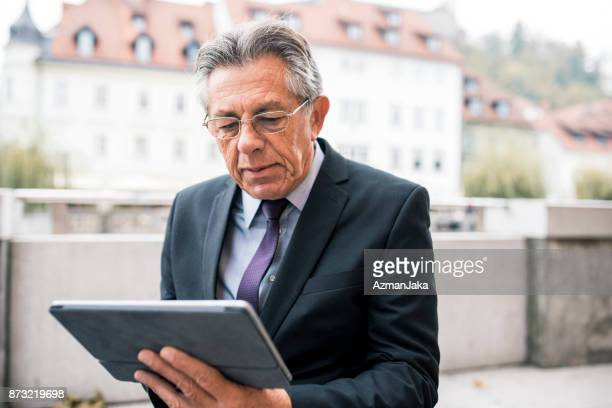Close up of a businessman using digital tablet
