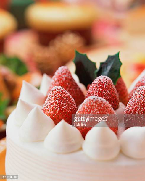 Close up of a cake decorated with strawberries