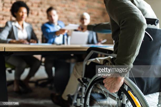 close up of a candidate in a wheelchair on a job interview. - persons with disabilities stock pictures, royalty-free photos & images