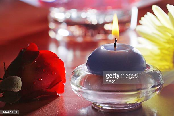 Close up of a candle and a flower
