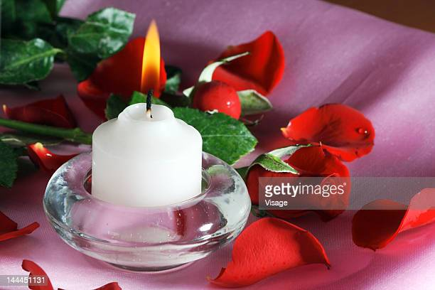 Close up of a candle and flowers