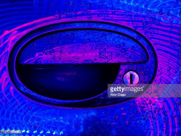 close up of a car door with drops of water at night. - plugging in stock pictures, royalty-free photos & images