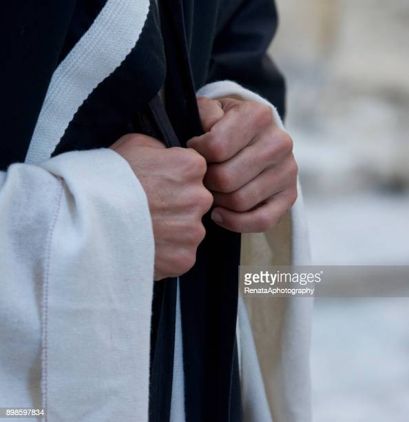 Close up of a Catholic priests hands
