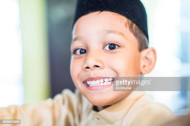 Close up of a cheerful young boy in traditional garments.