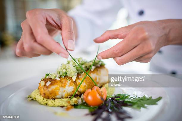 Close up of a Chef decorating a plate