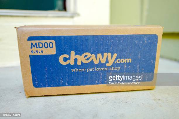 Close up of a Chewy.com box from pet-product online retailer Chewy, resting on a light-colored countertop, February 17, 2021.