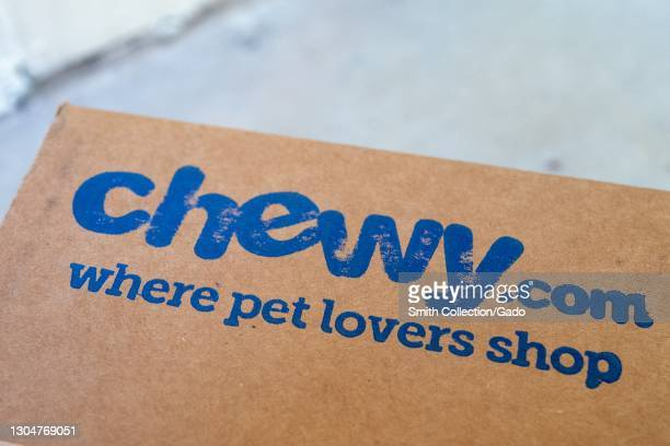 """Close up of a """"Chewy.com where pet lovers shop"""" logo on a box from pet-product online retailer Chewy, February 17, 2021."""