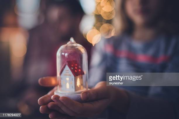 close up of a child holding christmas ornament. - religious celebration stock pictures, royalty-free photos & images