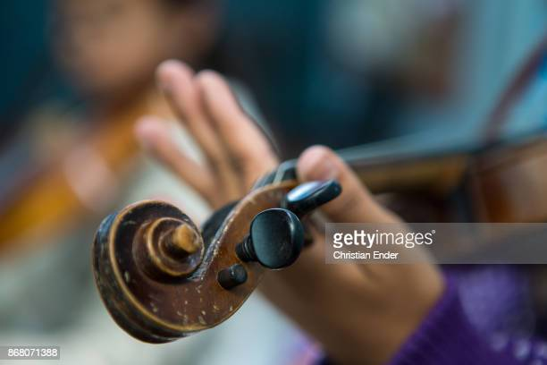 Close up of a child's hand playing the violin on February 24 2013 in Kalimpong India
