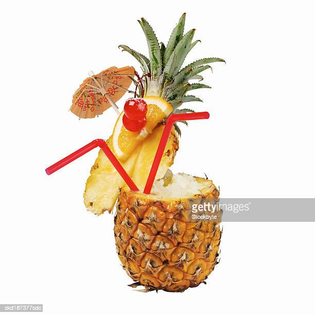 Close up of a cocktail in a pineapple
