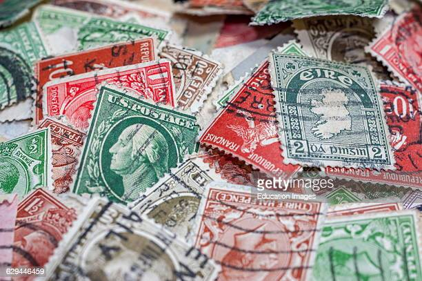 Close up of a collection of canceled international postage stamps