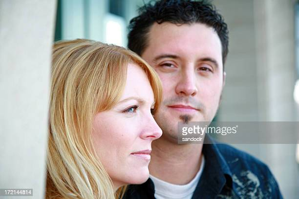 Close up of a couple looking in different directions