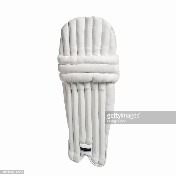 close up of a cricket leg pad - padding stock photos and pictures
