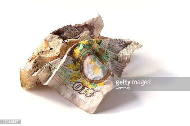 close up of a crumpled up ten pound note - ten pound note stock photos and pictures