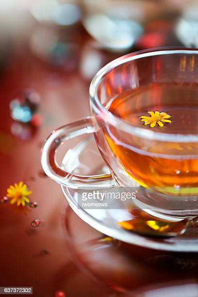 Close up of a cup of flower tea.