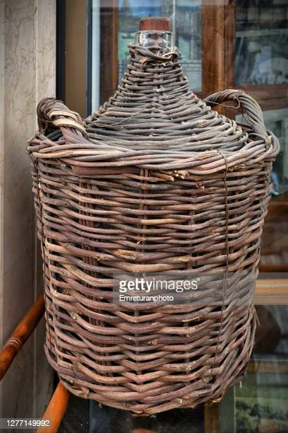 close up of a demijohn in a basket on glass table . - emreturanphoto stock pictures, royalty-free photos & images