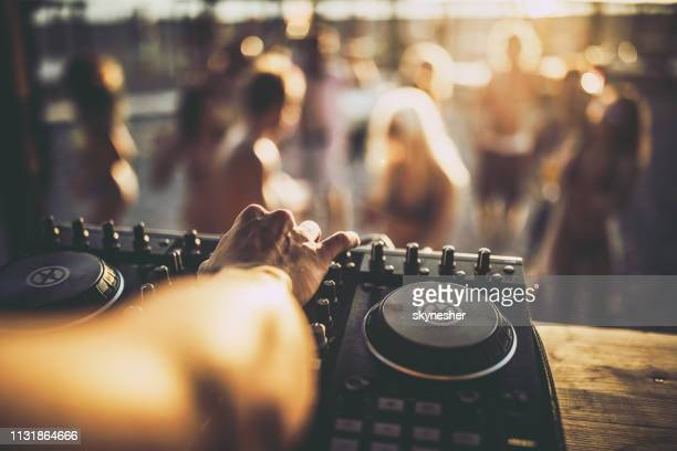 close up of a dj playing music on the beach party. - equaliser stock pictures, royalty-free photos & images