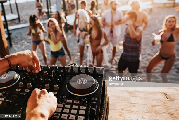 close up of a dj playing music on the beach party. - dj stock pictures, royalty-free photos & images