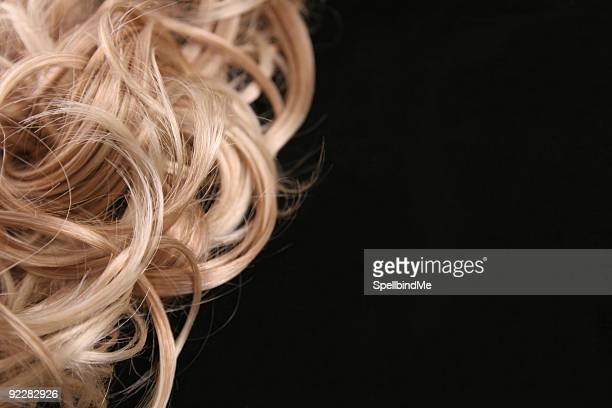 close up of a female's curly blonde hair - highlights hair stock pictures, royalty-free photos & images