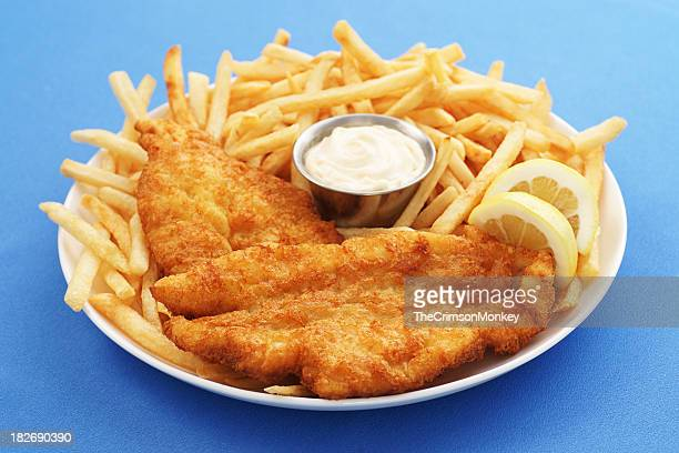 a close up of a fish and chips platter with dipping sauce - fried stock pictures, royalty-free photos & images