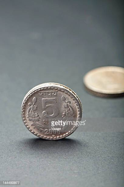 Close up of a five rupee coin