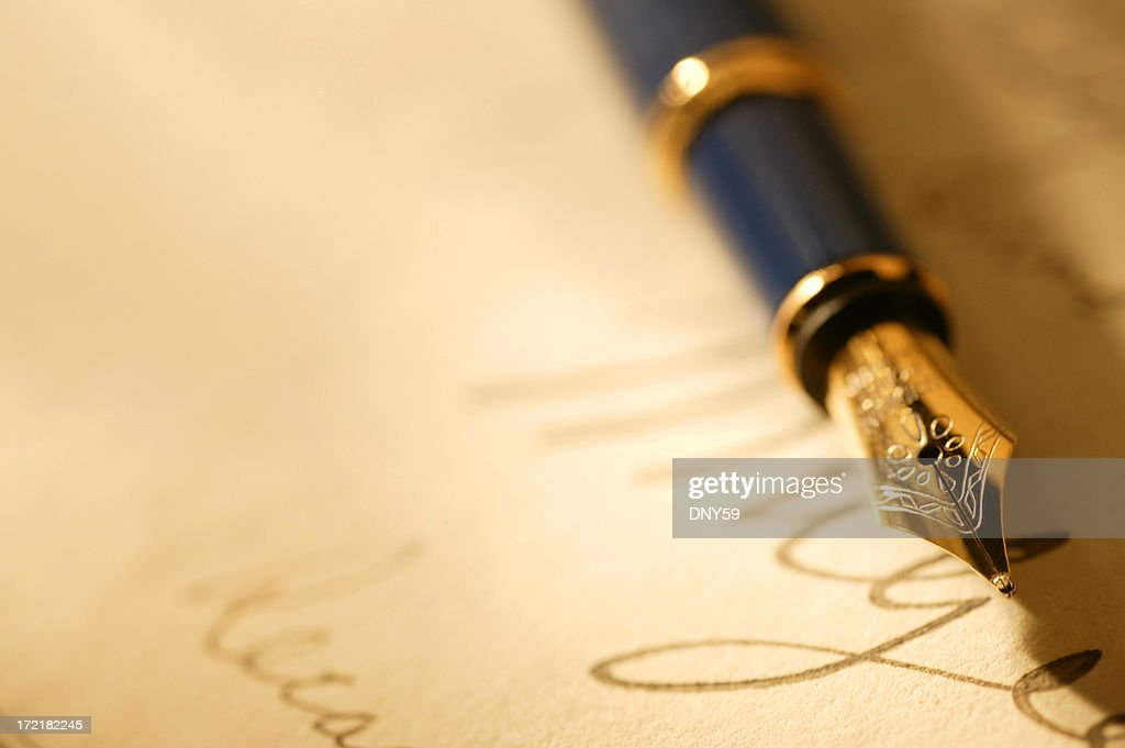 Close Up Of A Fountain Pen And Signature : Stock Photo