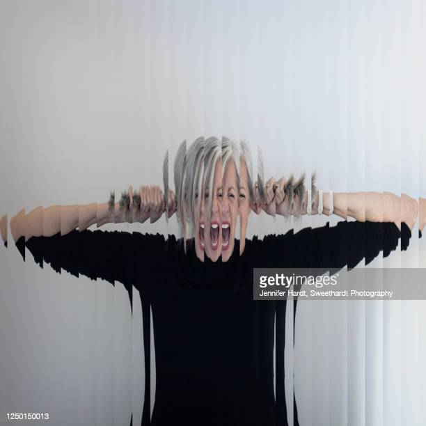 close up of a fragmented woman screaming through reed glass - jennifer reed stock pictures, royalty-free photos & images