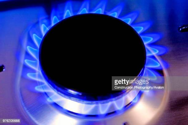 Close up of a gas burner with flame