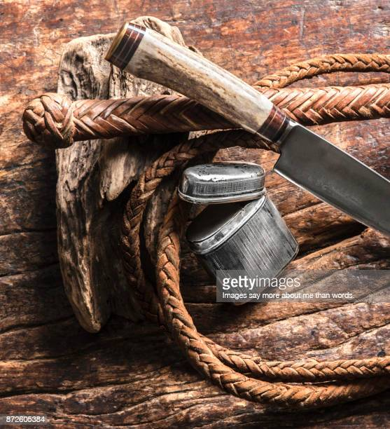 close up of a gaucho knife with whip and a silver case for hand-rolled cigarettes. - whip equipment stock pictures, royalty-free photos & images