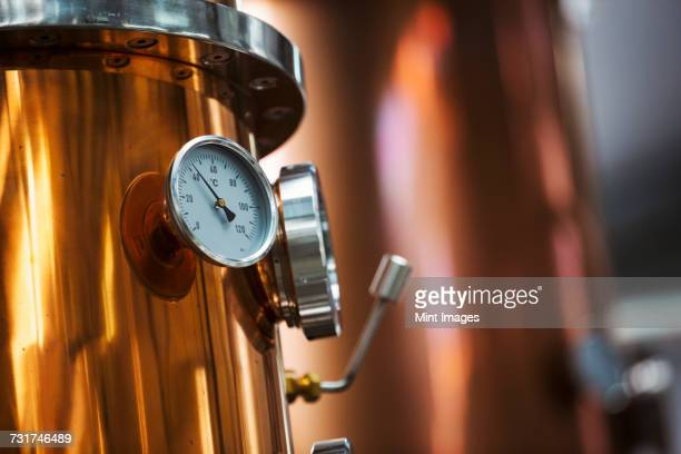 close up of a gauge on a copper brew kettle or fermentation chamber. - distillery stock pictures, royalty-free photos & images